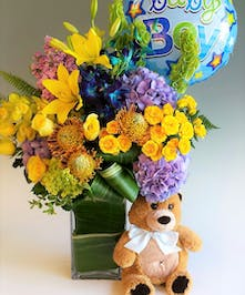 Blue, yellow and green flowers, such as lilies, roses, and hydrangea are among elegant greens and other florals. Premium Design includes 9