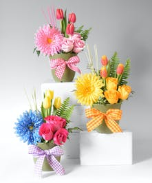 Keepsake clip on Silk Daisy inserted in a container. fresh flowers your office team or best assistant will love.