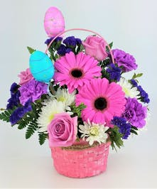 ceramic novelty vase filled with green, yellow and pink flowers. Roses, gerbera Daisy and tulips
