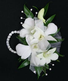 Dendrobium Orchids and tropical foliage are placed delicately on a wristlet corsage! Includes keepsake Rhinestone wristlet, crystal pins, and accents!