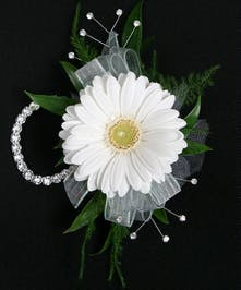 A fresh and fun corsage, this one features gerbera daisy in your choice of color! Includes keepsake Rhinestone wristlet, crystal pins, and accents!