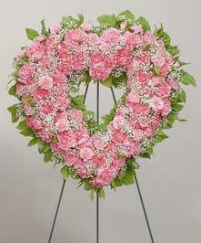 Classic carnations designed in the shape of a heart to remember one that you have lost. Featuring pink Carnations and babies breath.