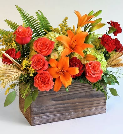 Filled with fresh Flowers to create a new happy memory of the fall season. Roses, hydrangeas and carnations with lilies.