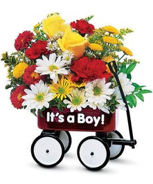 Red wagon with daisies, roses, and carnations