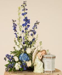 Mix of blue and white flowers featuring roses, delphinium, and other accenting flowers. Perfect to use as a special way to accent a memorial urn