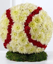 For those who loved and lived the game, a baseball made of carnations and chrysanthemums.