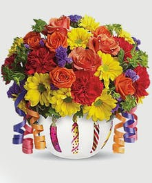 So bright and cheerful, this design features daisies, carnations and roses in a bubble bowl painted with birthday candles