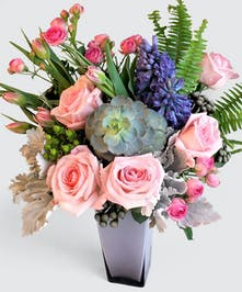 Mixed Pastel shades of roses, tulips , Hyacinth and modern succulents nested high quality lavender glass vase