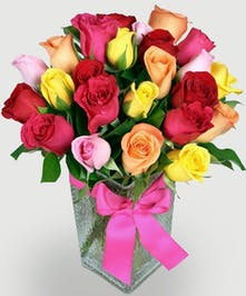 Assorted mix of beautiful roses in a vase. Choose From 24 stems in a vase or 12 stems of fresh roses. Rose color may vary due to availability