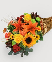 Decorate your table today and impress your guests! orange, yellow and reds with fall textures. Roses, lily and fall mums mixed with fresh greenery.