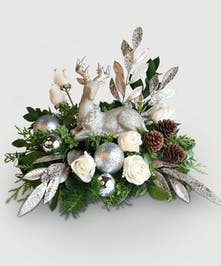 Let it snow with this lovely winter scene featuring a fine quality keepsake ivory Deer with pewter and gold accent.
