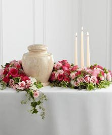 Roses in shades of pink create a stunning piece to surround and celebrate a life well lived. Approximate size of standard design is 28