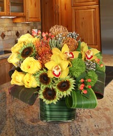 Exotic orchids, protea, roses, and sunflowers!