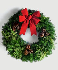This locally-made, custom wreath of lush evergreens, including cedar, juniper and pine, with a bow
