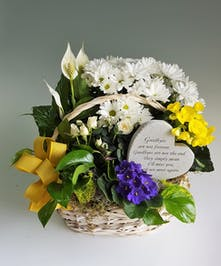A sweet, sympathy garden in white and yellow blooming plants with a memorial garden stone.