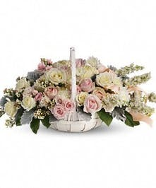 This delicate wicker basket filled with beautiful white flowers will surely spread some light to those you're thinking of. Perfect for the service or the home.