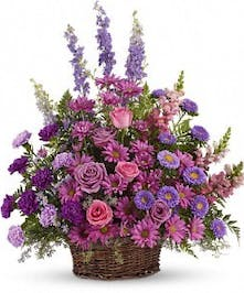 Purple tulips, fuchsia spray roses, lavender carnations, lavender larkspur, lavender button poms, jade spider chrysanthemums, green hypericum berries and more.