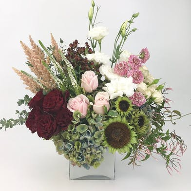 White cylinder vase with Premium Flowers