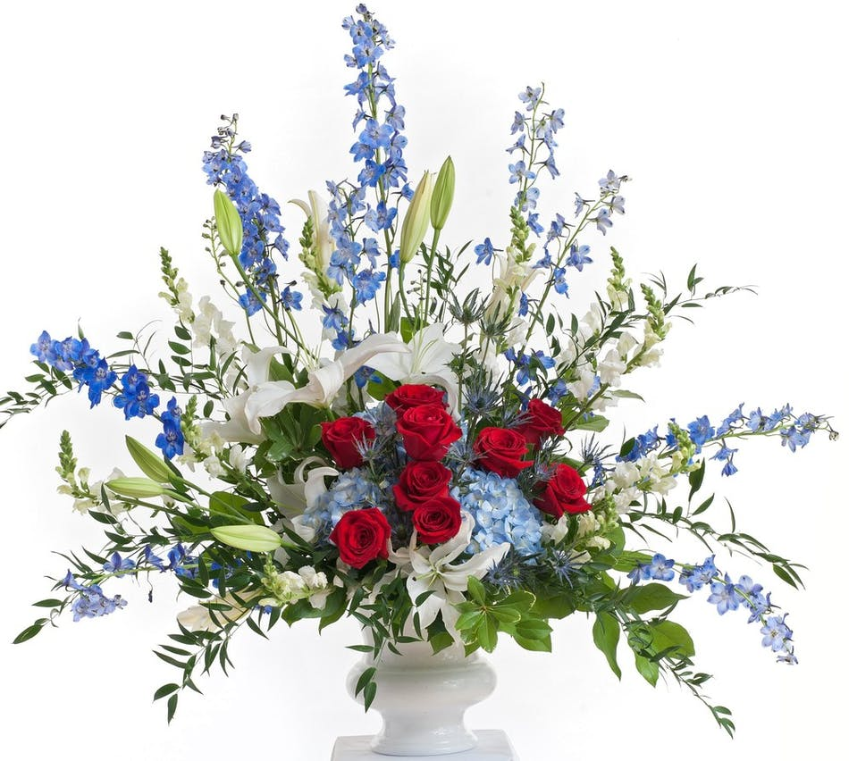 Patriotic fan shaped design stadium flowers patriotic floral design in red white and blue flowers featuring lilies roses and delphinium izmirmasajfo