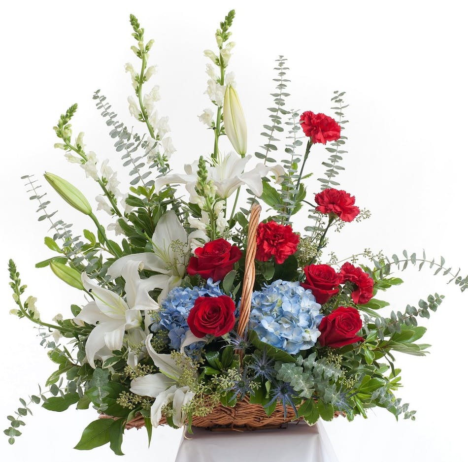 Patriotic floor basket stadium flowers patriotic floral basket design featuring red white and blue flowers traditional mix of flowers including izmirmasajfo