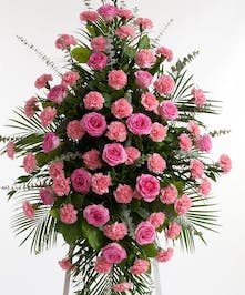 Classic pink easel display featuring complementing roses and carnations. Approximate size of the standard design is 28