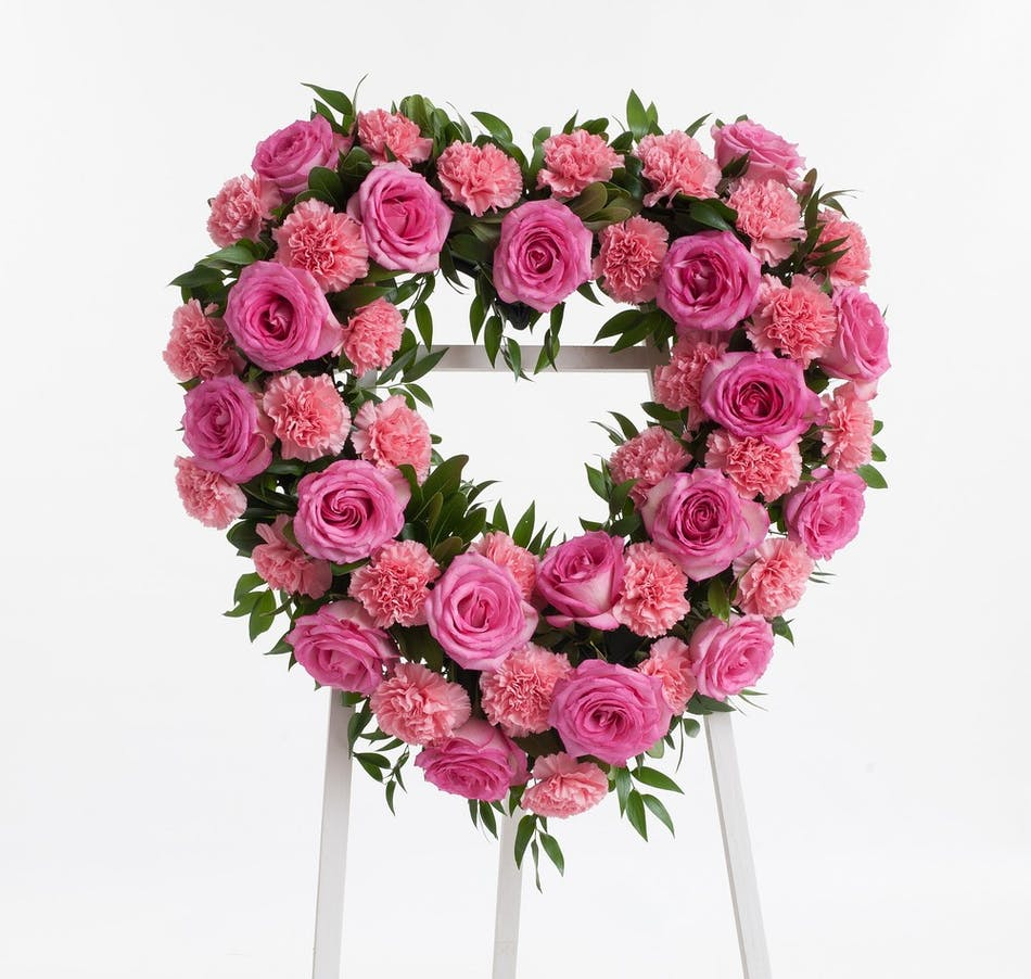 Pink rose and carnation open heart display stadium flowers stunning open heart easel display featuring complementing pink roses and carnations approximate size of the izmirmasajfo