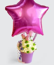 pastel color hydrangea, roses and mums combine in this spin off of the favorite treat. Choose with a cheerful balloon.