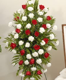 Classic red and white easel display featuring roses and carnations. Approximate size of the standard design is 28