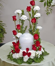 Red Roses and White Carnations beautifully display an urn in a traditional red and white theme. Approximate size of standard design is 18