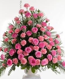 Classic mix or roses and carnations in shades of pink artfully designed in a white container. Approximate size for the standard design is 24