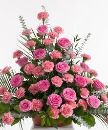 Classic mix of carnations and roses in shades of light and hot pink designed in a basket. Approximate size for the standard design is 24
