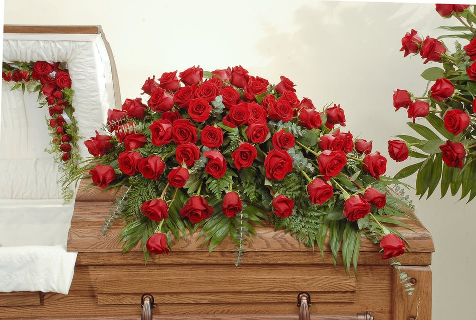 Red rose casket spray stadium flowers red roses with lush greens are artfully designed to make a statement in this casket spray mightylinksfo