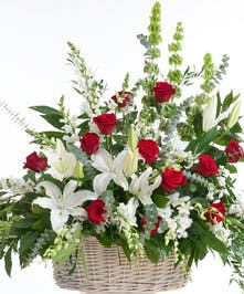 Classic mix of red roses and white lilies designed in a basket. Approximate size for the standard design is 28