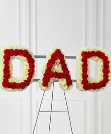 The word Dad made of roses, carnations, and chrysanthemums.