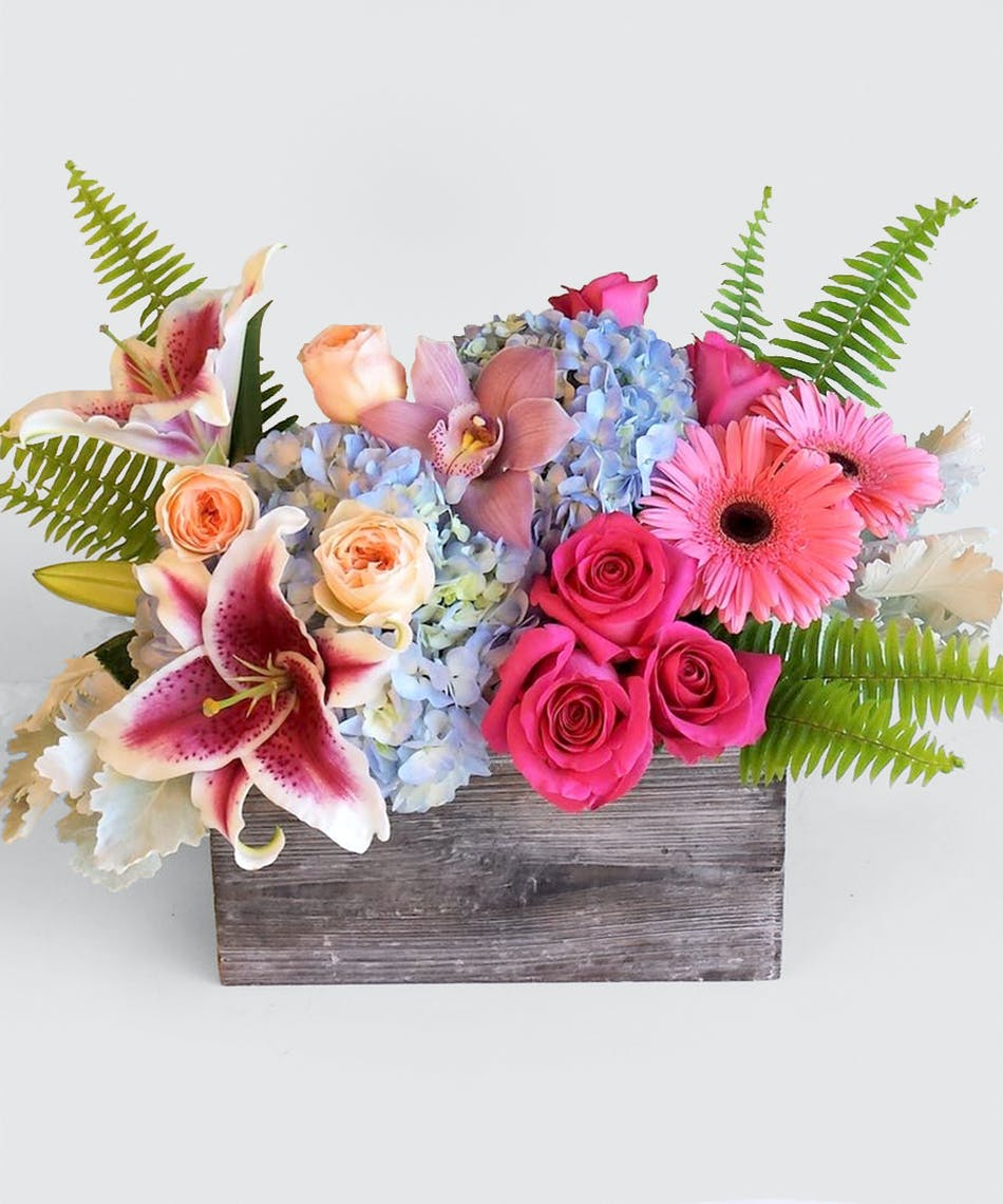 Birthday flowers seattle wa stadium flowers same day delivery a handmade wooded box overflowing with bright colored roses hydrangea and gerbera daisies izmirmasajfo