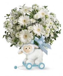 Our exclusive whimsical wooden lamb is covered in soft fleece and filled with beautiful blooms for a precious present they'll always remember!