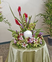 Vibrant tropical urn display featuring orchid, lilies, and other tropical flowers. Memorial Urn not included. Approximate size of standard design is 18