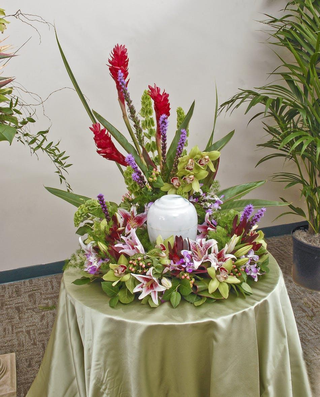 Tropical urn display stadium flowers vibrant tropical urn display featuring orchid lilies and other tropical flowers memorial urn izmirmasajfo