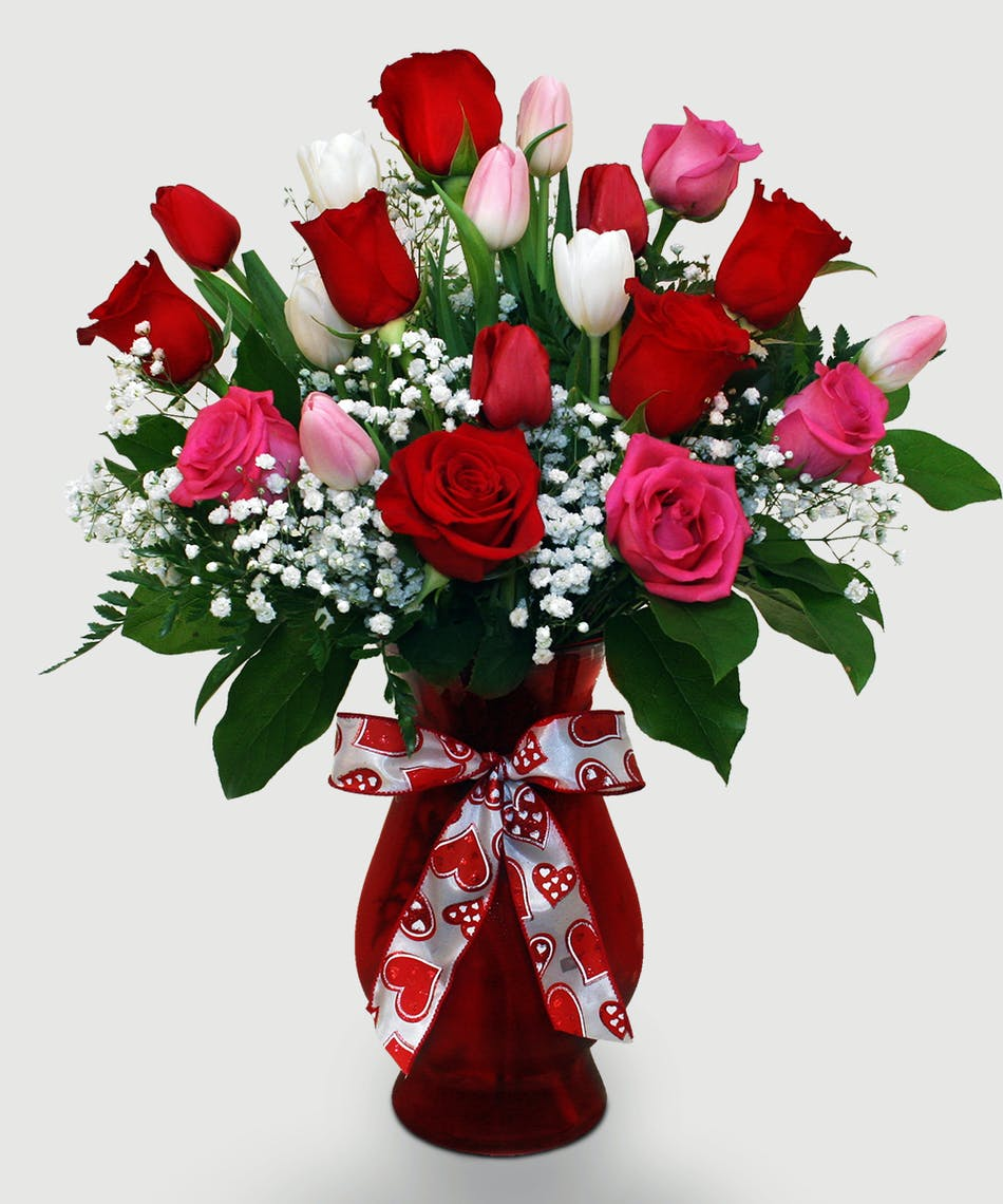 Let two lips meet this Valentine's after gifting this best-selling arrangement full of red and pink roses and tulips!