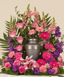 Perfect mix of roses, lilies, and daisy's in striking shades of pinks and purples. This design is perfect for and urn placement at a memorial service.