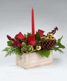 elegant display of  red candles with fresh winter greens, pine cones and Golden ornaments.