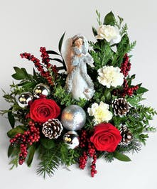 Red roses and fresh holiday greens are a perfect gift for the Angel collector.