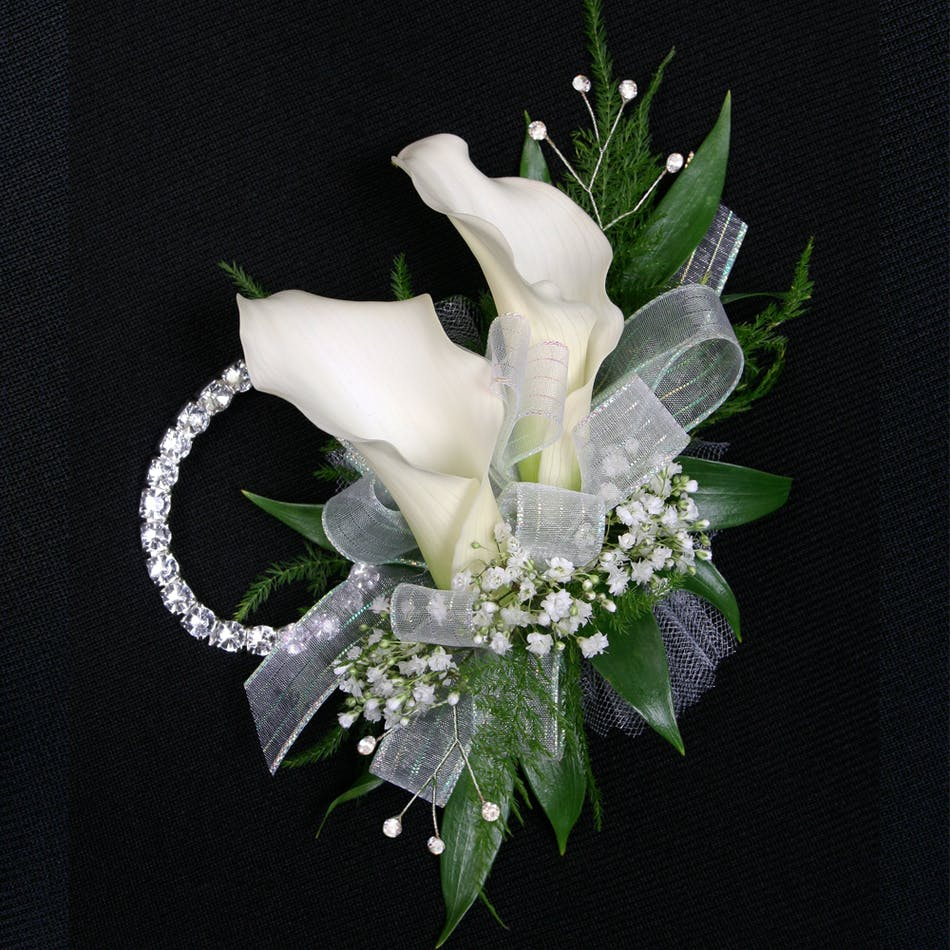 Calla lily package stadium flowers two elegant and contemporary calla lilies create this beautiful wristlet and is accompanied by a coordinating izmirmasajfo