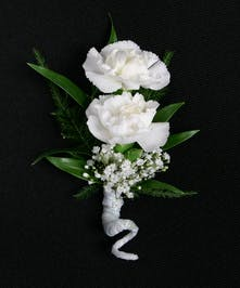 Sweet combo of 2 delicate miniature carnation blooms with greenery accents.