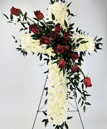 A beautiful cross display of white carnations and red roses. Approximate size of the standard design is 12