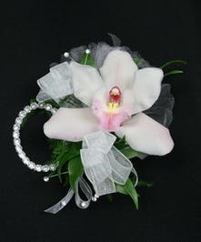 A tropical Cymbidium orchid on a rhinestone wristlet with a matching boutonniere included! Also includes a keepsake Rhinestone wristlet, crystal Gems, and accents!