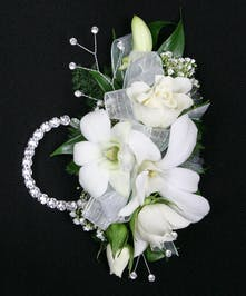 Dendrobium orchids and complimenting roses arranged on a wristlet with a coordinating boutonniere. Includes a keepsake rhinestone wristlet, crystal gems, and accents!