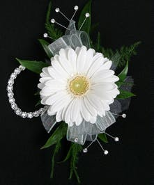 A classic gerbera daisy in your choice of color on a wristlet with a matching boutonniere. Also includes a keepsake Rhinestone wristlet, crystal Gems, and accents!